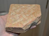 A good sized, thick and heavy Medieval floor tile featuring an interlaced design, London. SOLD
